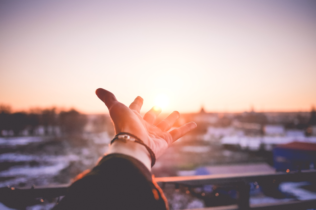 mans-hand-is-trying-to-reach-the-sun-picjumbo-com